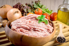 Raw ground meat in wood bowl. Stock Photos