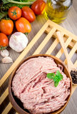 Raw ground meat in wood bowl. Royalty Free Stock Photos