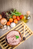 Raw ground meat in wood bowl. Royalty Free Stock Photography