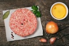 Raw ground pork meat steak cutlets Stock Photos
