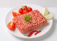 Raw ground pork and vegetables Stock Photos