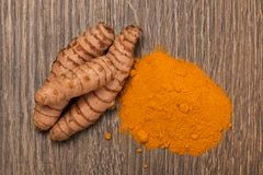 Raw and ground turmeric, stock photography