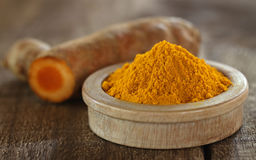 Raw and ground turmeric Stock Photography