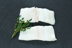 Raw haddock fillets - top view. Raw haddock fillets on black board - top view Stock Photos