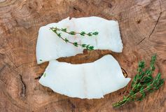 Raw haddock fillets - top view. Raw haddock fillets on wooden board - top view Royalty Free Stock Photo