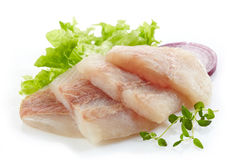 Raw hake fish fillet pieces. On a white background Royalty Free Stock Image