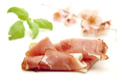 Raw ham with basil Royalty Free Stock Images