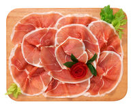Raw ham on a chopping board Royalty Free Stock Images