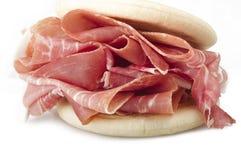 Raw ham leg sliced Stock Image