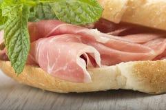 Raw ham leg sliced Stock Photos