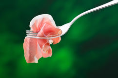 Raw ham. Slice of raw ham on a fork Stock Images