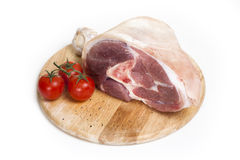 Raw ham on a white background. With tomatoes Stock Image