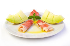 Raw ham and yellow melon Royalty Free Stock Photos