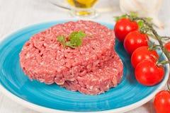 Raw hamburger Stock Photos
