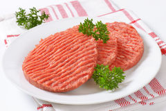 Raw hamburger patties Stock Photo