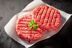 Raw Hamburger Patties Topped with Fresh Parsley Royalty Free Stock Images