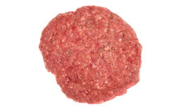 Raw hamburger patty. A raw hamburger patty isolated on white Royalty Free Stock Photography