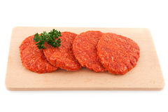 Raw hamburgers royalty free stock images