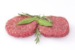 Raw hamburgers isolated on white background. Some raw hamburgers isolated on white background Royalty Free Stock Photos