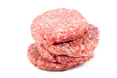Raw hamburgers with transparent protective film. Raw hamburgers with protective film in white background Royalty Free Stock Image