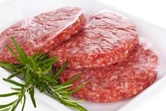 Raw hamburgers. Stock Photo