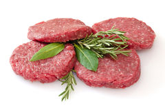 Raw hamburgers  on white background Royalty Free Stock Image