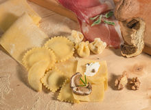 Raw handmade dough and Italian homemade ravioli,open and closed,filled with ricotta cheese and mushrooms. Stock Photo