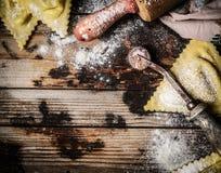 Raw Handmade ravioli Triangoli on rustic wooden background Royalty Free Stock Photos