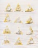Raw handmade ravioli  Triangoli on white wooden background Stock Photography