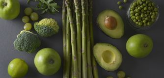 Raw healthy food clean eating vegetables: asparagus, cucumber, basil, green peas, avocado, broccoli, lime, apples, grapes,. Raw healthy food clean eating stock photography