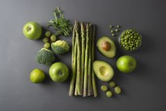 Raw healthy food clean eating vegetables: asparagus, cucumber, basil, green peas, avocado, broccoli, lime, apples, grapes,. Raw healthy food clean eating royalty free stock photography