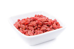 Raw and healthy goji berries in white bowl Stock Photo