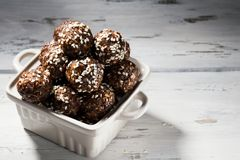 Raw vegan homemade paleo energy balls with rolled oats, nuts, dates and sesame, horizontal, copy space stock images