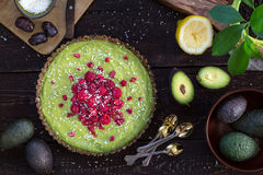 Raw Healthy Paleo Avocado Lemon Cake with Banana and Raspberries stock image