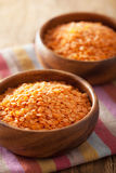 Raw healthy red lentils in bowl Stock Image