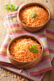 Raw healthy red lentils in bowls Stock Image