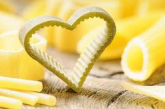 Raw heart shaped pasta Stock Photography
