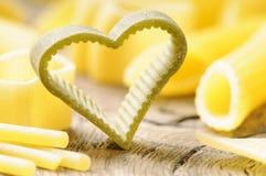 Raw heart shaped pasta Stock Photography