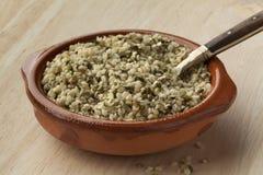 Raw hemp seeds royalty free stock photo