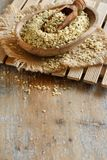 Raw Hemp seeds. On a wooden background royalty free stock photo