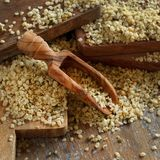 Raw Hemp seeds. On a wooden background royalty free stock photography