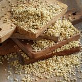 Raw Hemp seeds. On a wooden background royalty free stock images