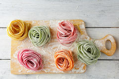 Raw homemade color pasta on cutting board Royalty Free Stock Images