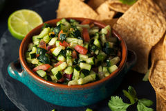 Raw Homemade Cucumber Pico De Gallo Salsa. With Chips Royalty Free Stock Image