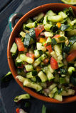 Raw Homemade Cucumber Pico De Gallo Salsa. With Chips royalty free stock photo