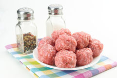 Raw homemade meatballs prepared for cooking, isolated Stock Photo