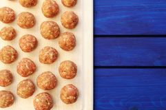 Raw homemade meatballs on white plastic cutting board with copys Royalty Free Stock Photography