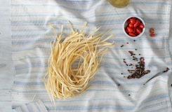 Raw homemade noodles on a light rustic wooden table. Top view Royalty Free Stock Photography