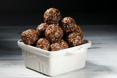 Raw homemade paleo energy balls with rolled oats, nuts, dates and sesame, horizontal, close up royalty free stock photos