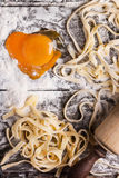 Raw homemade pasta with with egg yolk as heart Stock Images